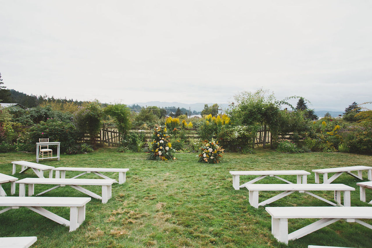 yellow floral arch farm ceremony