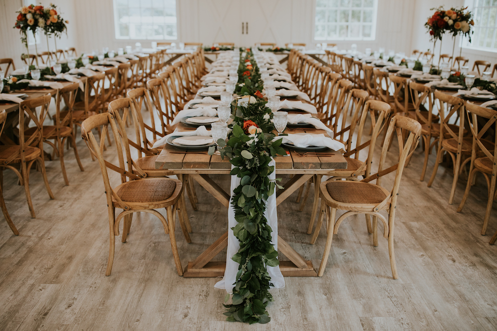 Long table dinner with greenery