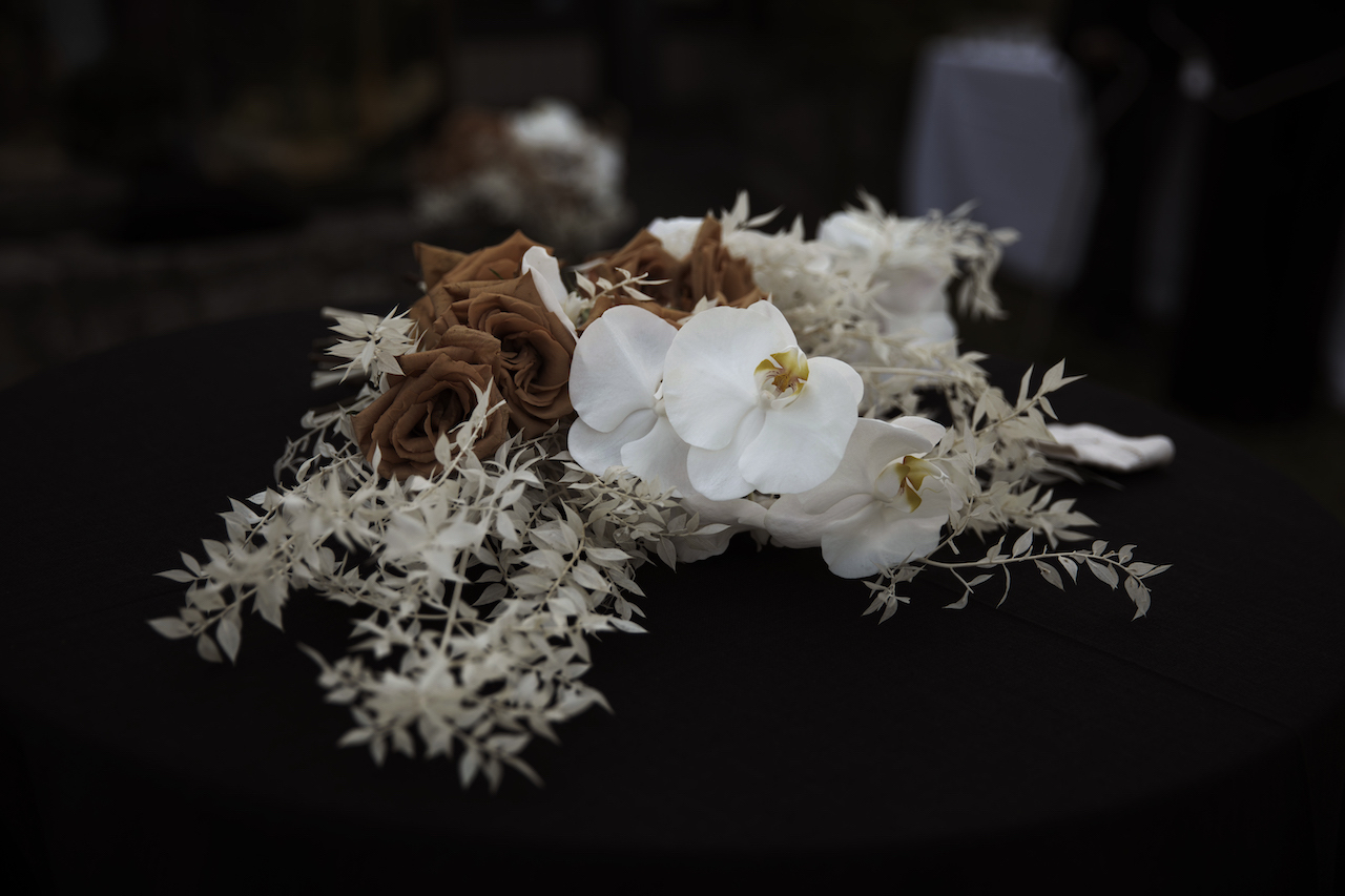 orchid and dried floral bridal bouquet