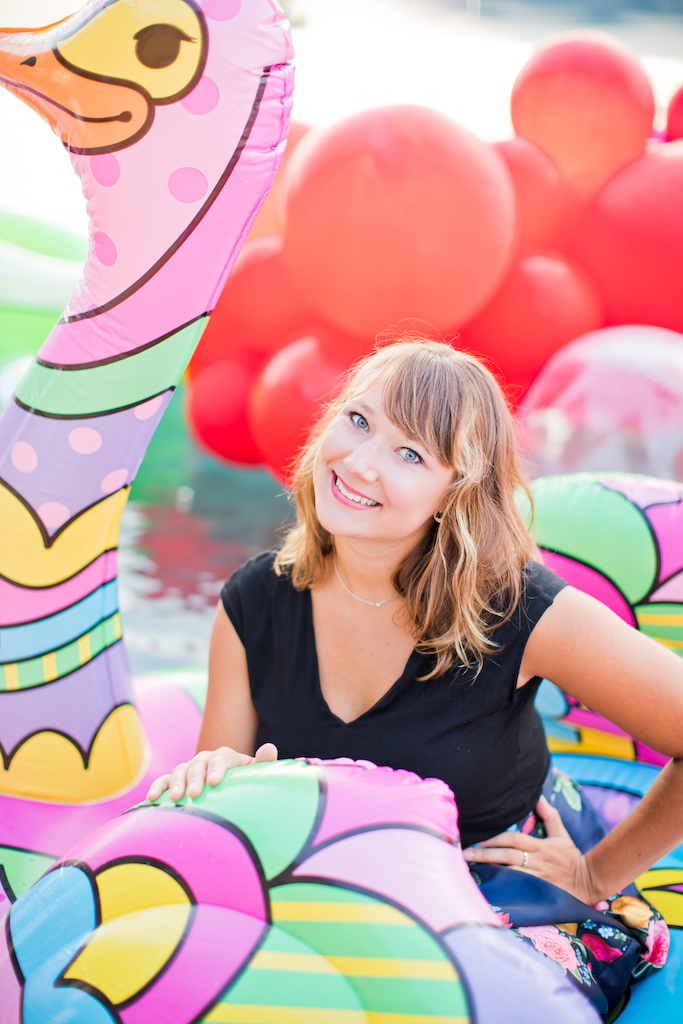 Girl on colourful inflatable