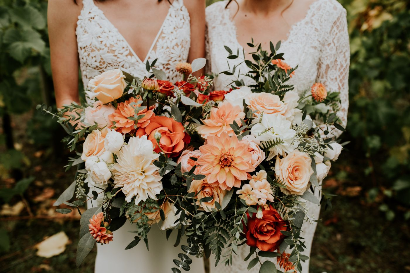 Orange bridal bouquet, two brides