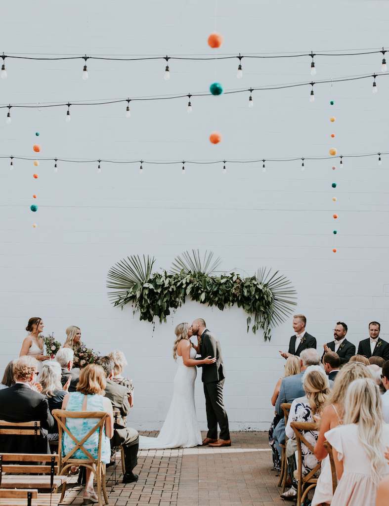 pom pom white wall wedding ceremony